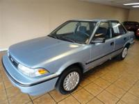 This 1990 Toyota Corolla 4dr LE Sedan features a 1.6L