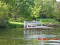Level lake lot with sandy swim area, 4.15 acres See: