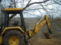 1991 John Deere Backhoe 4 wheel drive, has cab but some