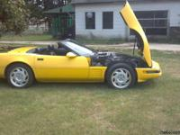 1991 corvette convertible, yellow, w/ blk top. p/s,p/w,