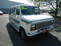 This 1991 Ford Econoline Cargo Van E150 features a 5.0L