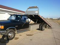 Super Duty Ford rollback with wheel lift. Completely