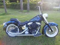 UP FOR SALE IS A 1991 HARLEY DAVIDSON SOFTAIL. NEW
