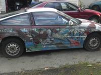You are looking at a 1991 Honda CRX, automatic