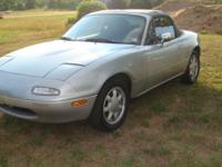 This 1991 Mazda Miata is a perfect car for the summer!