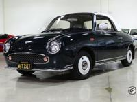 The Nissan Figaro is a RHD (right hand drive) Retro