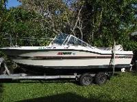 BOAT: 20 ft. 1991 Stratos DC2000 dual console outboard