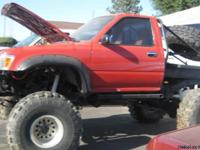 1991 Toyota Rockcrawler, Red in color, 350 Chevy motor,