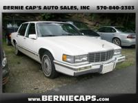 Options Included: Split Bench Seats, Air Conditioning,