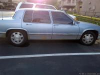 THIS IS A 1992 BLUE CADILLAC DEVILLE,