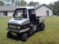 1992 Cushman 4 Wheel Truckster for sale. Has new paint,