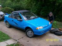 $9.00, TO FILL IT UP.LITTLE 3 CYL. GEO METRO,BLUE WITH