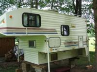 Slide in camper,toilet,3 way fridge,3 burner stove,12