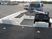 This is a 20 foot Vision Bass boat with a Johnson 175