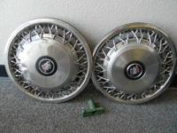 "2 -15"" spoked wheel covers from a 1998 Buick"