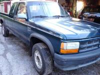 THIS IS A 1993 DODGE DAKOTA EXT CAB WITH A BED LINER