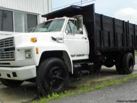 1993 Ford F700 Dump Truck, 16 ft. flat bed with