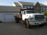 Ford F-700 with a little less than 84,000 miles gets