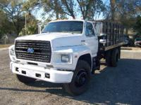 1993 Ford F700 Stake Body Flat Bed. 7.0 Liter Engine,