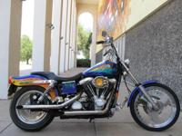 You are looking at a 1993 Harley-Davidson Dyna Wide