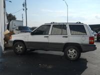 Options Included: Clock, Tilt Steering Wheel, Rear