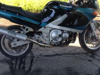 This is a 1993 Kawasaki ZX600-E1 Ninja ZX-6E, in