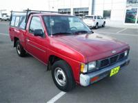 This Red 1993 Nissan 4x2 Truck is powered by a 2.4L 4