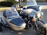 The bike and sidecar have original factory paint and