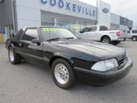 This 1993 Ford Mustang LX has a sharp Black exterior
