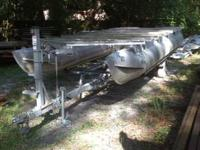 This is a 1994 21' pontoon boat and trailer. This is a