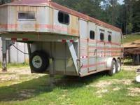 1994 Titan 3 horse gooseneck trailer in good condition.