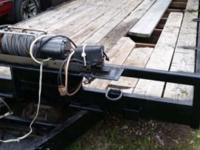 Tilt bed 10 ton electric winch and brake assist. Needs
