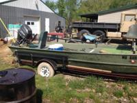 1994 model boat and factory trailer with a 2004 30hp