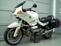 1994 BMW R1100RS, pearl white with 83276 miles. This