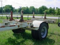 1994 Butler 30' pole trailer with electric brakes.