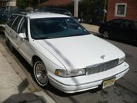 For sale is a 1994 Chevy Caprice Station Wagon white