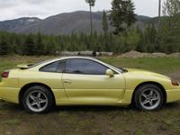 Turn heads with this uncommon yellow Dodge Stealth, and
