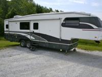 This well-loved trailer features 2 slide-outs, one in