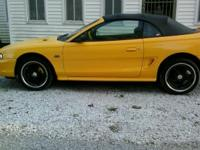 1994 Yellow Ford Mustang GT Cobra Convertable. Top is