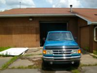 THIS 1994 FORD RANGER 4X4 REGULAR CAB IN BLUE WITH