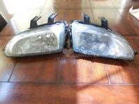 I have one comeple set of factory head lights for a