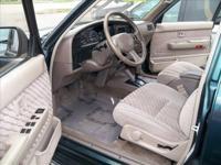 Options Included: Clock, Tilt Steering Wheel, Cloth