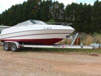 This is a red/white 1994 Sundowner Winn 215 Sundowner