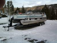 1995 18 Ft Pontoon boat. 60 HP oil injected Mercury