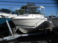 This 1995 20' Sea Swirl Striper cuddy cabin is powered