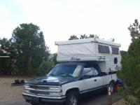 7ft. long. camper has been stored in side, there are no
