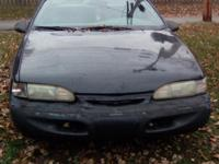 Black coupe, runs good, decent tires, brand new