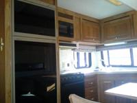 1995 Hitchhiker 2 with 1 slideout. Fifth wheel. Newer