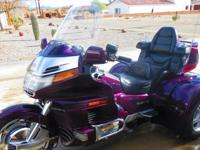 This 1995 Honda Gold Wing / Champion Trike has less