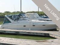 This 1995 Larson is a roomy midcabin cruiser that